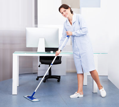 Female cleaner performing Office Cleaning using a mop