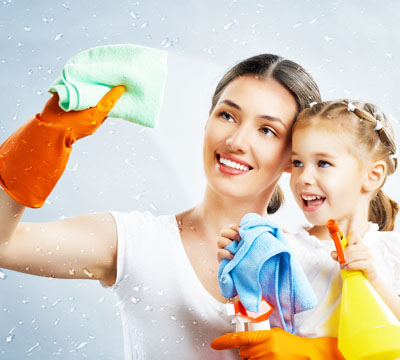 Smiling Mother and cute daughter does cleaning