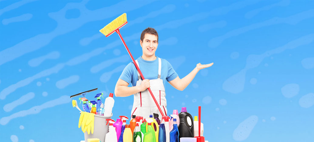 Smiling male cleaner with cleaning equipment and mop